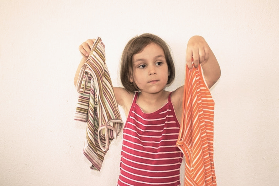 Girl Choosing Her Outfits