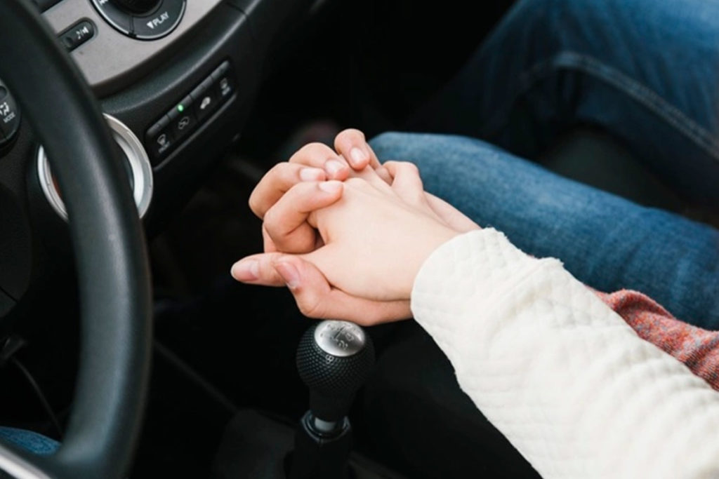 holding hands while driving
